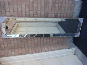 LARGE MIRROR WITH CUT GLASS MIRROR FRAME. 20INCH X 80 INCHES.