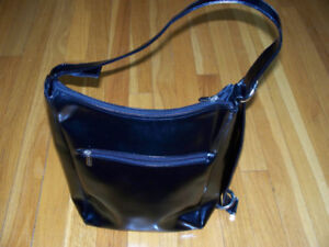 Danier Leather zipped black purse with adjustable strap