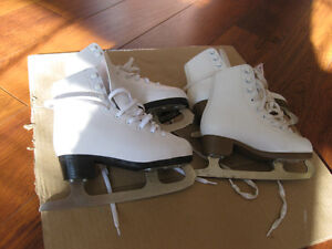2 pairs of girl's figure skates. sizes 1 and 13. good condition,