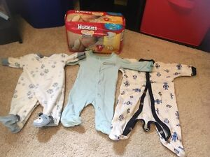 Lot of preemie boys clothing and 1 bag preemie diapers