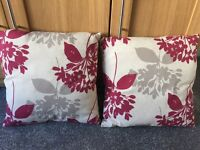 2 matching cushions, as new.