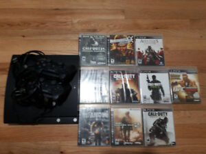 PS3 with 2 wireless remotes & 10 games