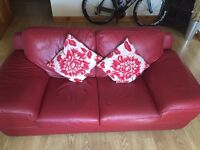 2 seater red leather settee/ sofa