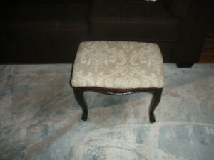 Small  upholstered  foot  stool.