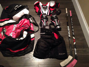 One 8 junior skates, 2 hockey sticks, gear and bag