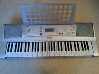Yamaha keyboard YPT-300(PSR E303) With Adapter & Book