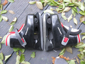 Two pairs of young childs skates