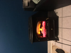 Electric wood stove space heater