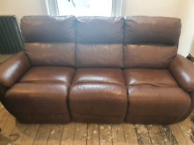 Reclining brown leather sofa and two reclining chairs.