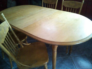 Selling Solid wooden Dining table with  4 matching chairs.