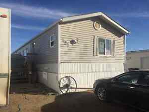 In Estevan, Nice mobile home for sale (or to be moved) REDUCED!!
