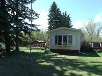 A RARE OPPORTUNITY Mobile Home  for  sale on rented acreage