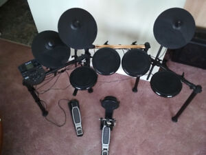 Electric Drum set sticks and lesson book included!