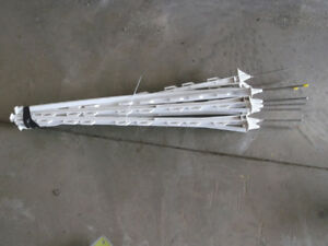 garden /raccoon electric fencer, 10 posts, and 1 roll wire/ tape