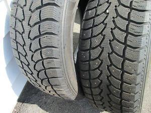 265/60R18 WINTER TIRES WITH STUDS LIKE NEW 2 tires only