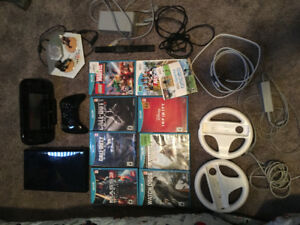 Nintendo Wii U with games and cables.