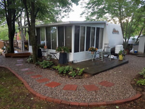 Trailer, 3 season room, and shed
