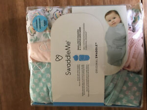 """Brand new in package 3 """"Swaddle Me""""  original swaddles."""