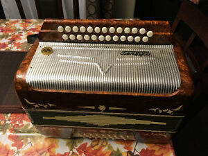 Accordion with case for sale
