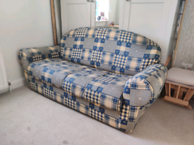Yellow and blue patterned sofa bed