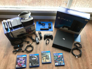PlayStation 4 Pro 1TB and PSVR with games and move controllers