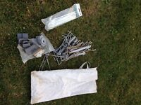 Caravan pegs, straps and cushions for awning poles against caravan