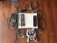 X BOX 360 plus 30 Games WI FI AND HEADPHONE as on pictures