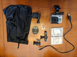 GoPro Hero 4 Silver with waterproof case and accessories