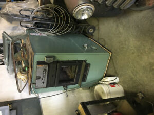 Wood/oil combination furnace