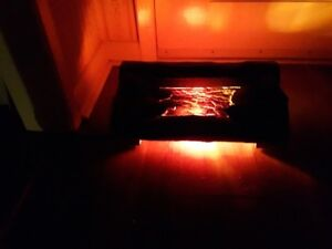 plug in glowing amber fireplace  (vintage)