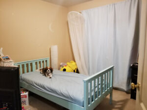 Twin bed, frame and curtains