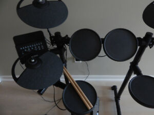 Yamaha DTX400K electronic drums with sticks