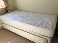 Classic single bed with extra bed stored under