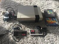 Nintendo NES game console with games