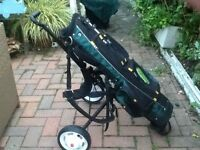 Young persons golf bag and trolly