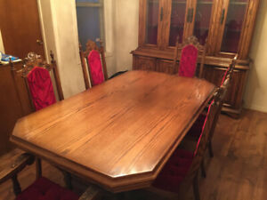 Solid oak, hand carved dining room set with china cabinet