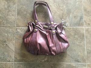 Kathy Van Zealand purses