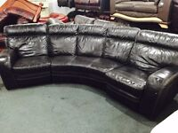 Curved black leather recliner sofa