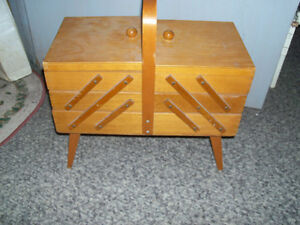 Neat old vintage sewing stand..folds out on each end...