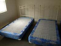 Pair of twin beds / frames and box springs  /headboards