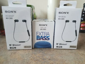 BRAND NEW SONY WIRELESS EARPHONES AND SONY PORTABLE SPEAKER