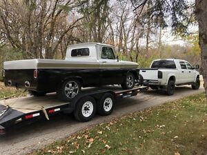 CUSTOM HAULING/MOVING. OPEN/ENCLOSED TRAILERS GREAT RATES!!