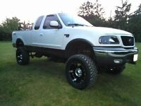 2002 Ford F-150 lifted supercharged! !!