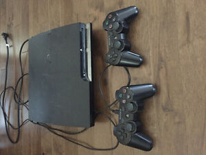PlayStation 3 slim. Two controllers and many games!