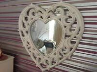 Heart shaped mirror.