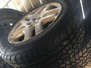4 Barely used tires with used rims