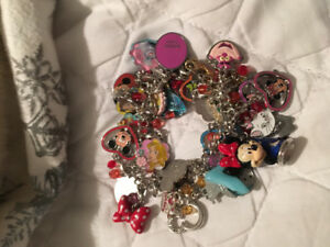 Disney charm bracelet with over 40 charms $50 or best offer.
