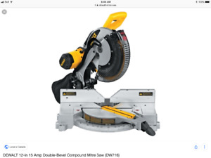 Dewalt double bevel mitre saw in mint shape with portable table