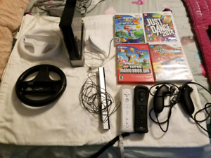 Nintendo Wii with 4 games and 2 controllers