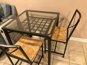 Glass Top Ikea Table and Two Rattan Chairs